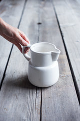 Holding White McCoy Pitcher