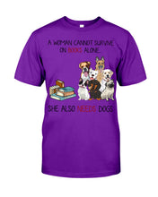 Load image into Gallery viewer, A Woman Cannot Survive On Books Alone She Also Needs Dogs Guys Tee