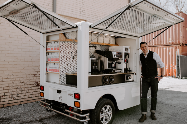 Ian Picco standing in front of the Topeca ETUK coffee truck