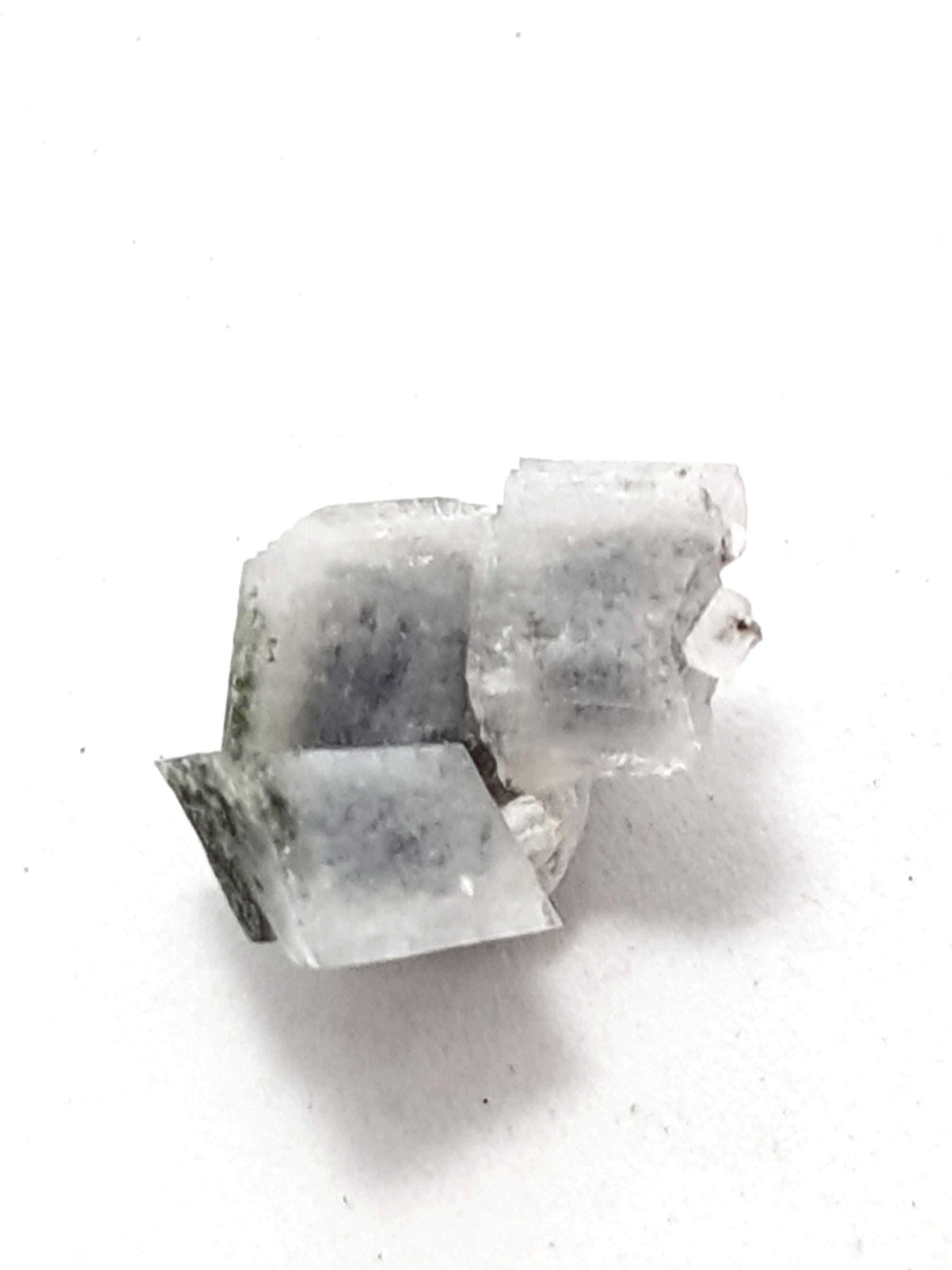 adularia crystals. There are three in a cluster. They are white. They are rhombic
