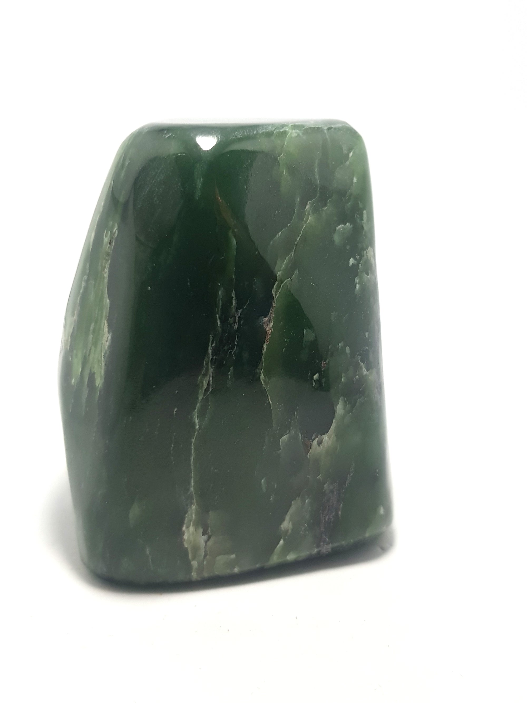 Nephrite jade freeform. Dark green with some white and green patches