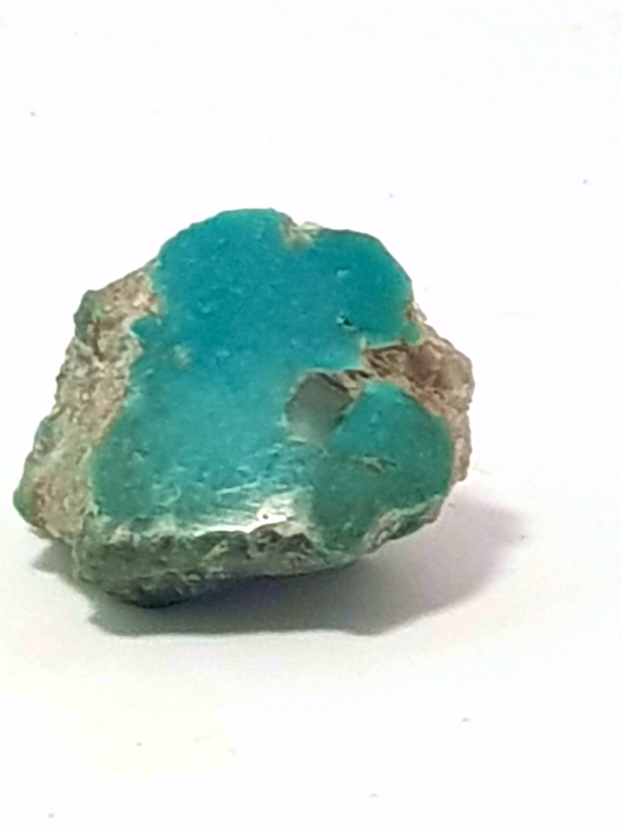 semi polished sample of kingman turquoise. This sample has a fully polished face. The sample is blue green.