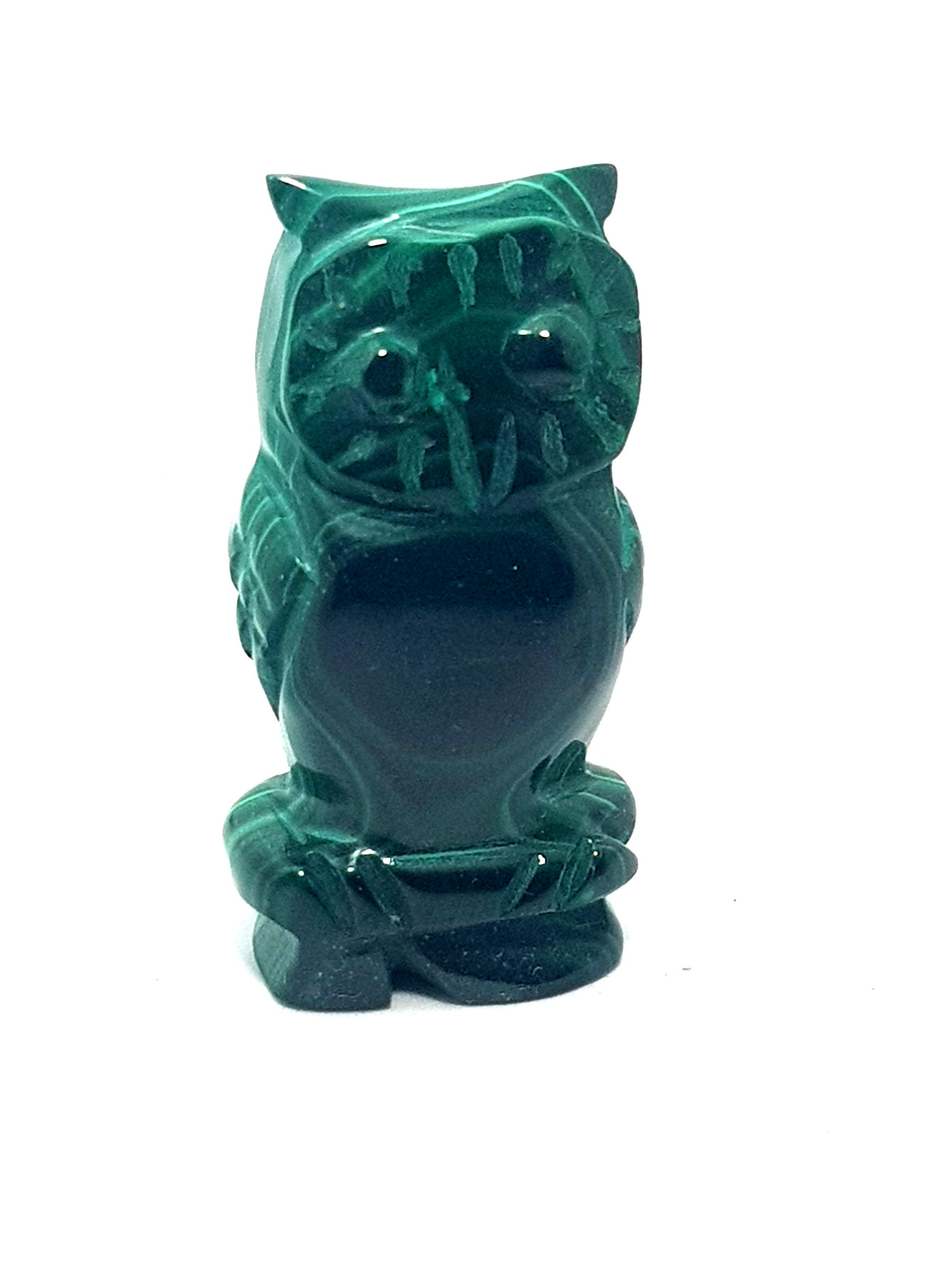 A carved malachite owl. Miniature. Dark green to pale green banded malachite.