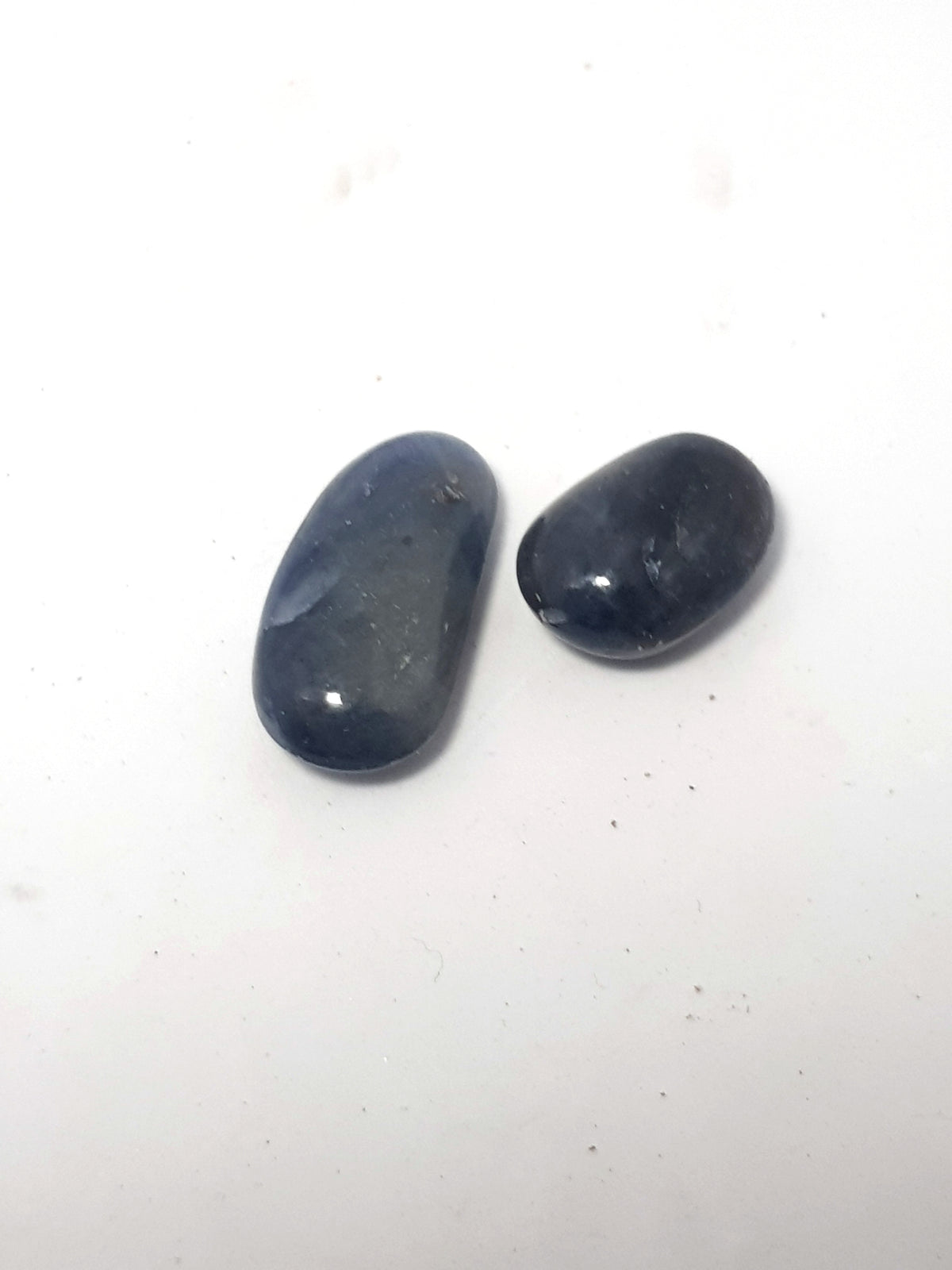two small polished blue saphire. they are not gem grade and have no clarity