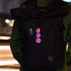 Pink reflective buttons on GOT Bag