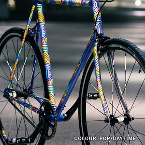 Blue bike with colourful reflective stickers