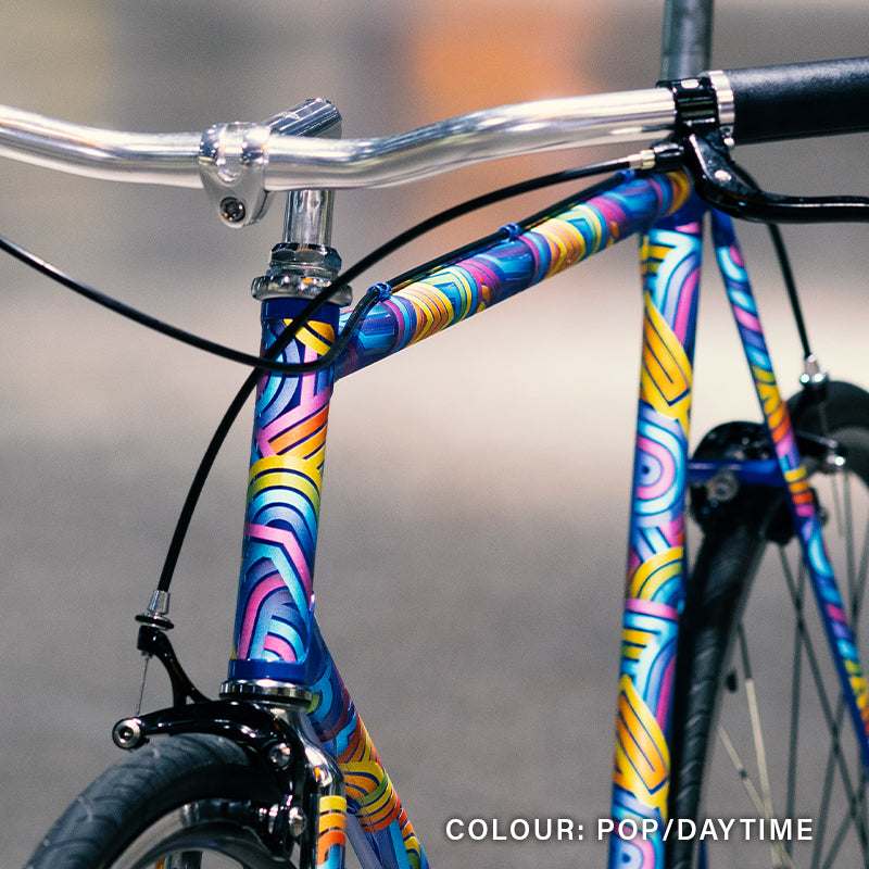 Blue bike with colourful reflective stickers, front