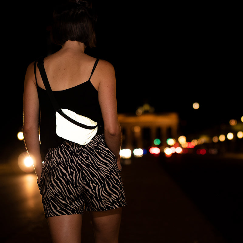 reflective yellow pouch, brandenburger gate, night time