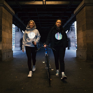 reflective hoodies, bike, girls walking