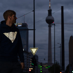 Berlin Alexanderplatz, Reflective Hoodie and road sign, city lights