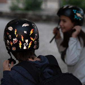 Kids with helmets and reflective stickers