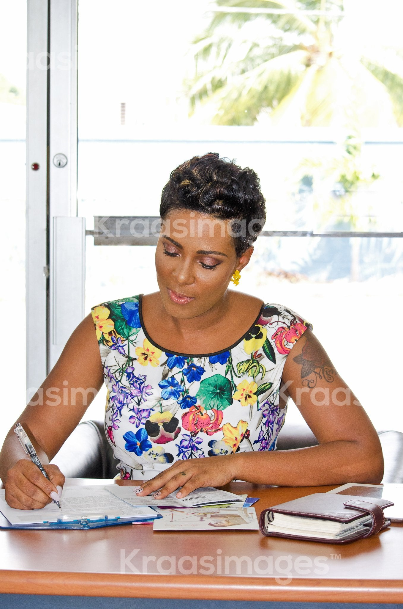 Focused businesswoman writing notes at desk stock photo