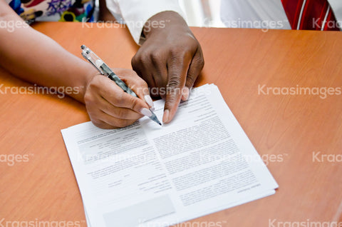 Close up of man pointing to signing a document stock photos