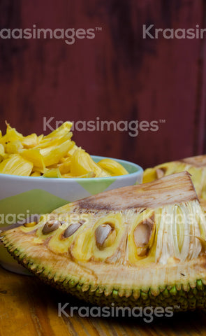 Fresh Jackfruit in dish, half of Jackfruit on wooden table stock photo