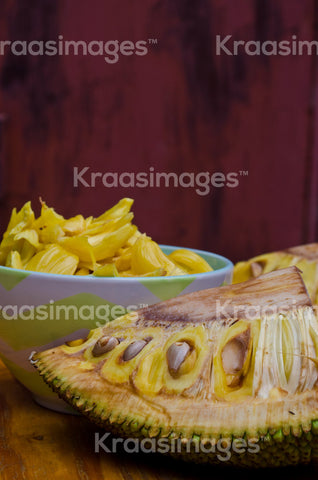 Fresh Jackfruit in dish, half of Jackfruit on table