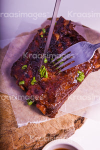 Barbecue pork ribs on wooden cutting board stock photo