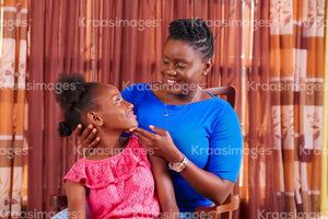 Mother looking at child with joy stock photo