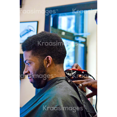 Client getting trimmed at barber shop stock photo