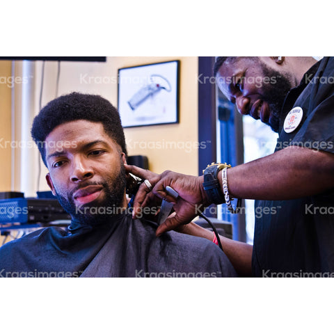 Man getting trimmed with electric razor stock photo