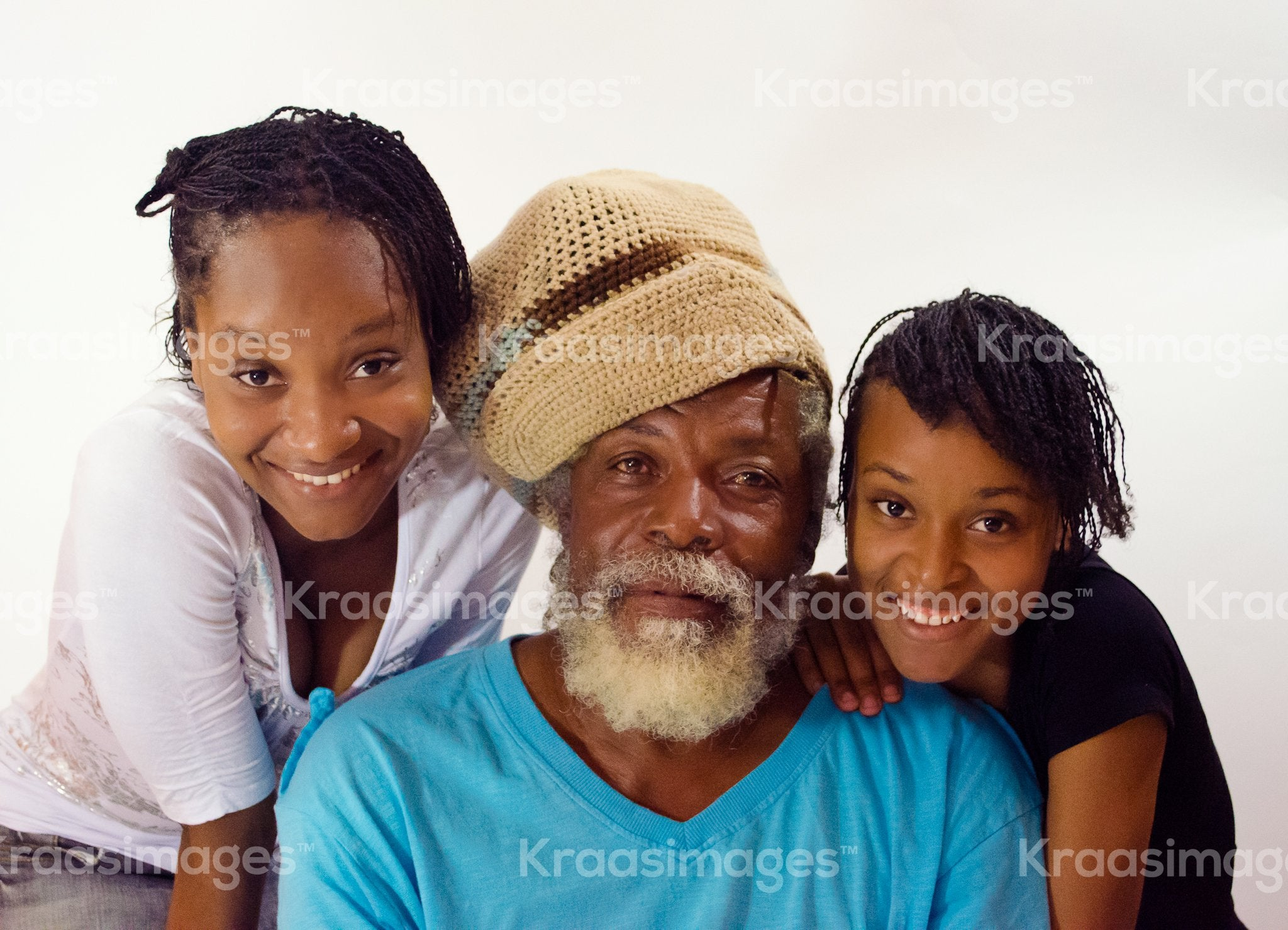 Dad with two daughters stock photo