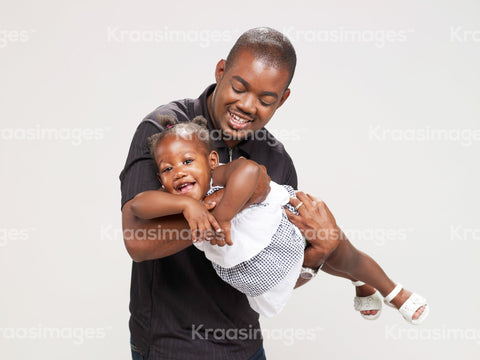 Playful father and daughter