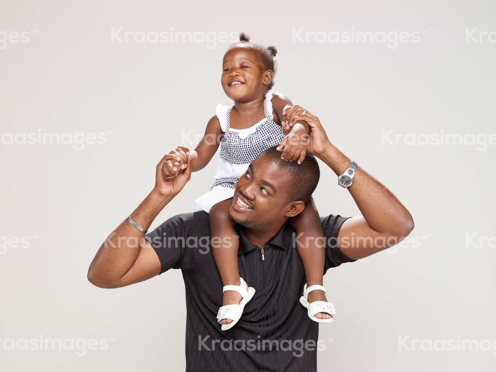 Playful father and daughter moment stock photo