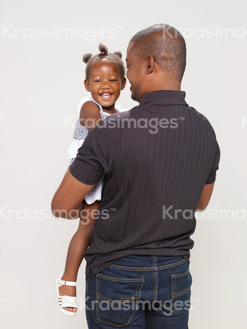 Father playing with his young daughter stock photo