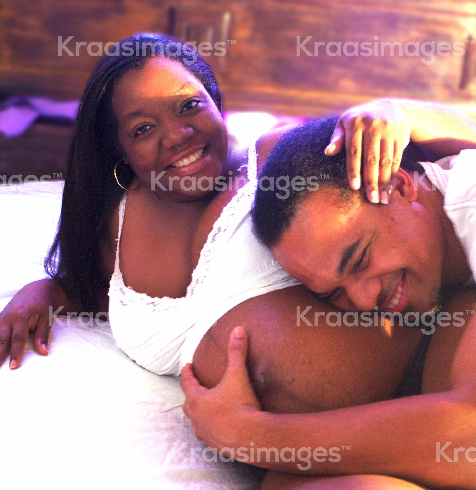 Husband hugging newborn through wife belly stock photo