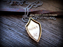 "Load image into Gallery viewer, Shield Pendant, ""Brave"" with Crossed Arrows Necklace"