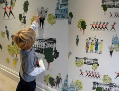 Young boy uses magnets on wall