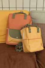 Kuprinė. Dydis [L], faded orange + seventies green + retro yellow