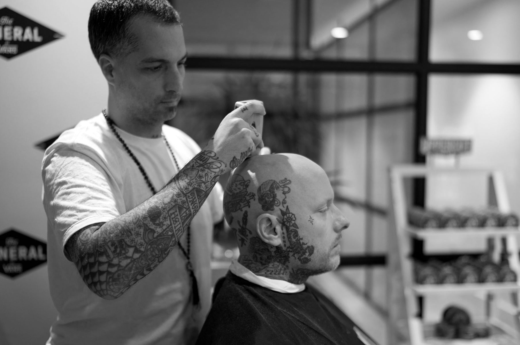 Man having head shaved by barber