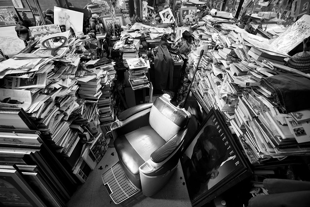 Piles of books around a barber chair