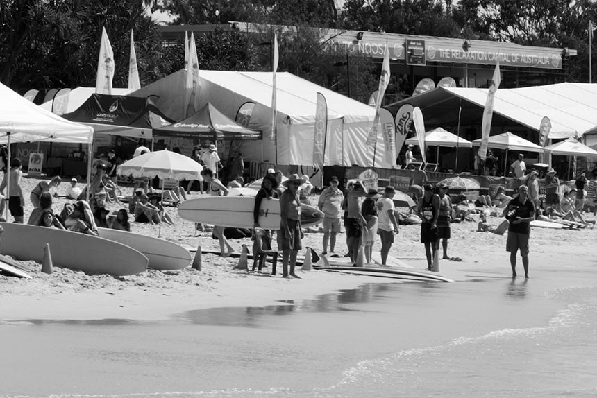 Group with surfboards on beach