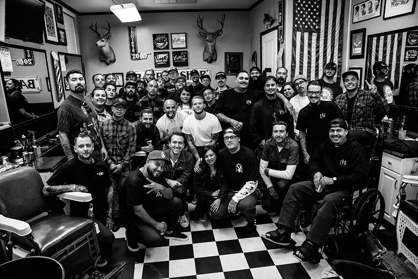 Many barbers posing together