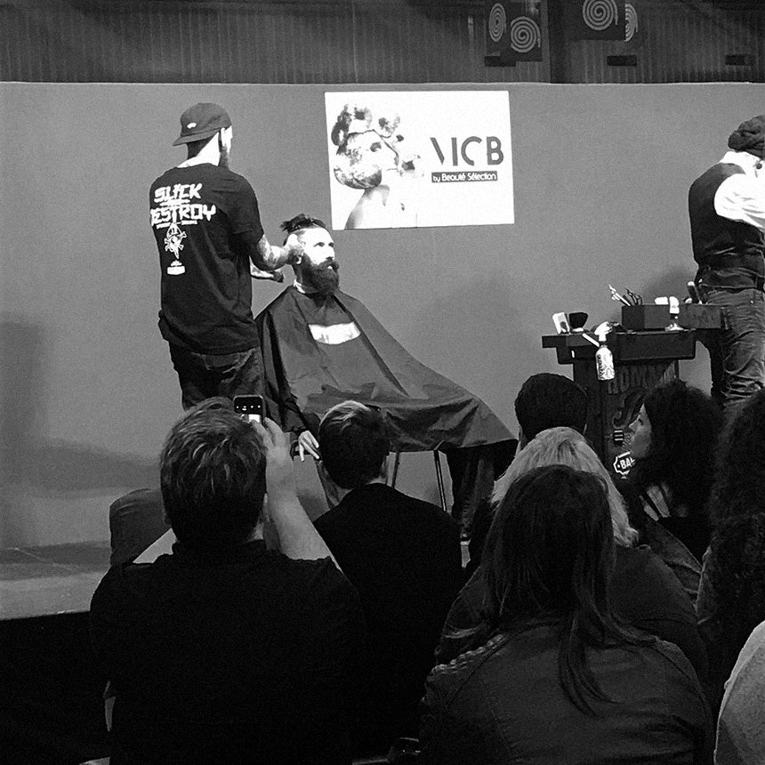 Barber cutting hair on stage