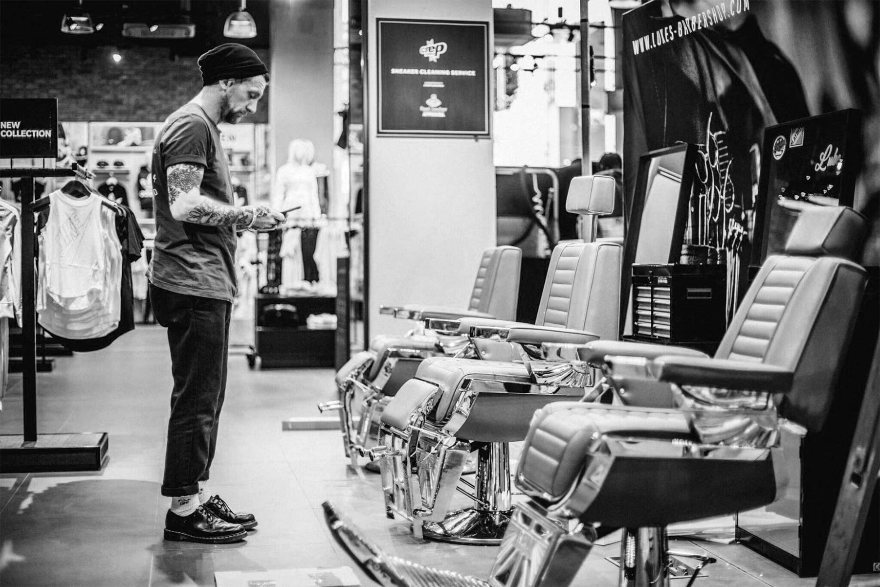 Man inspecting barber chairs
