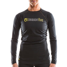 An image of a woman wearing a Women's Barrier Long-Sleeve Crew-Neck Shirt from SeasonFive.