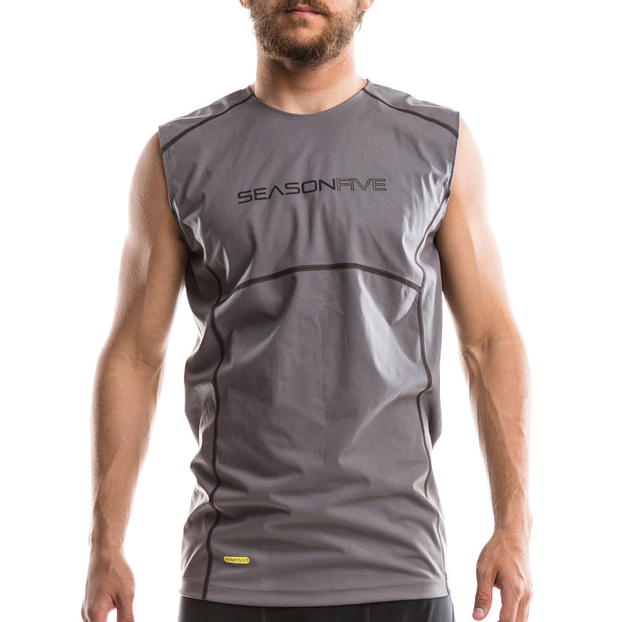 An image of a man wearing a Barrier Sleeveless Shirt from SeasonFive.