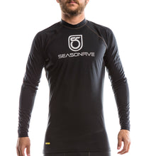 An image of a man wearing a Men's Barrier Long-Sleeve Crew-Neck Shirt from SeasonFive.