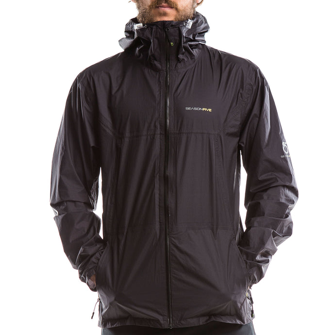 An image of a man wearing a Men's Crestone Rain Shell from SeasonFive.
