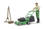 gardener with lawnmower and equipment