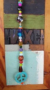Beautiful chime with colorful beads, peace sign