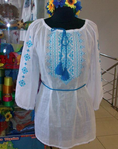 Off white boho batiste top with blue embroidery and tassels