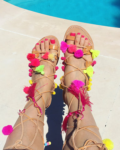 Capri pompom and tassel gladiator sandals