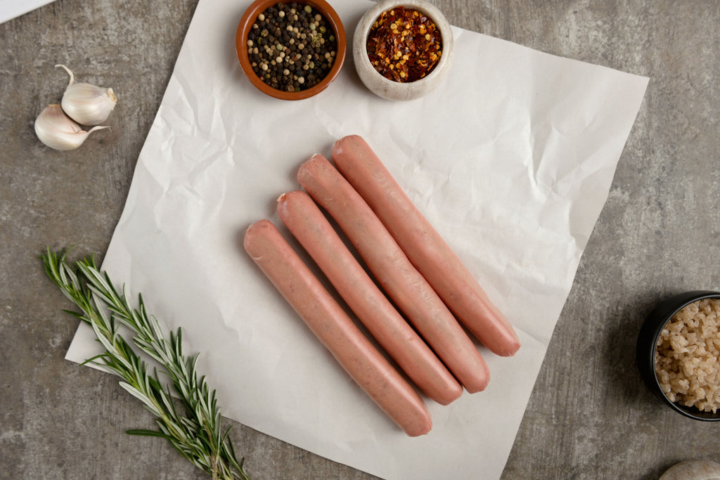 Beef Sausages by Delica Butchers Melbourne on butter paper and garnish