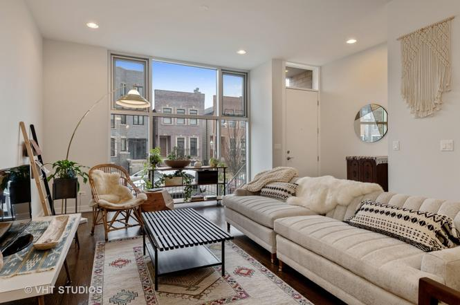 Eskell's chic inventory perfectly stages modern homes like this property on the 606 Chicago.