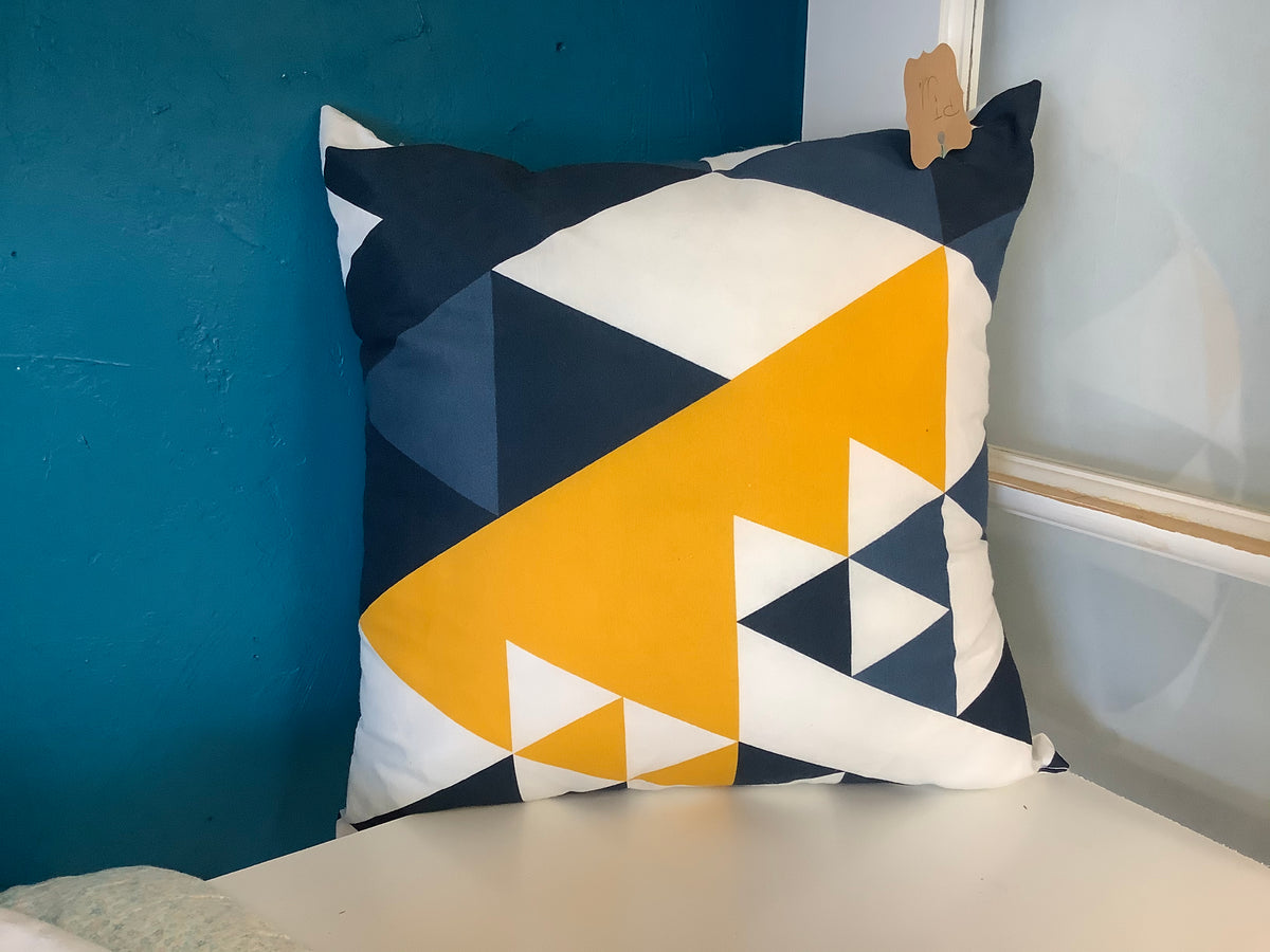 Navy, yellow, and white pillow