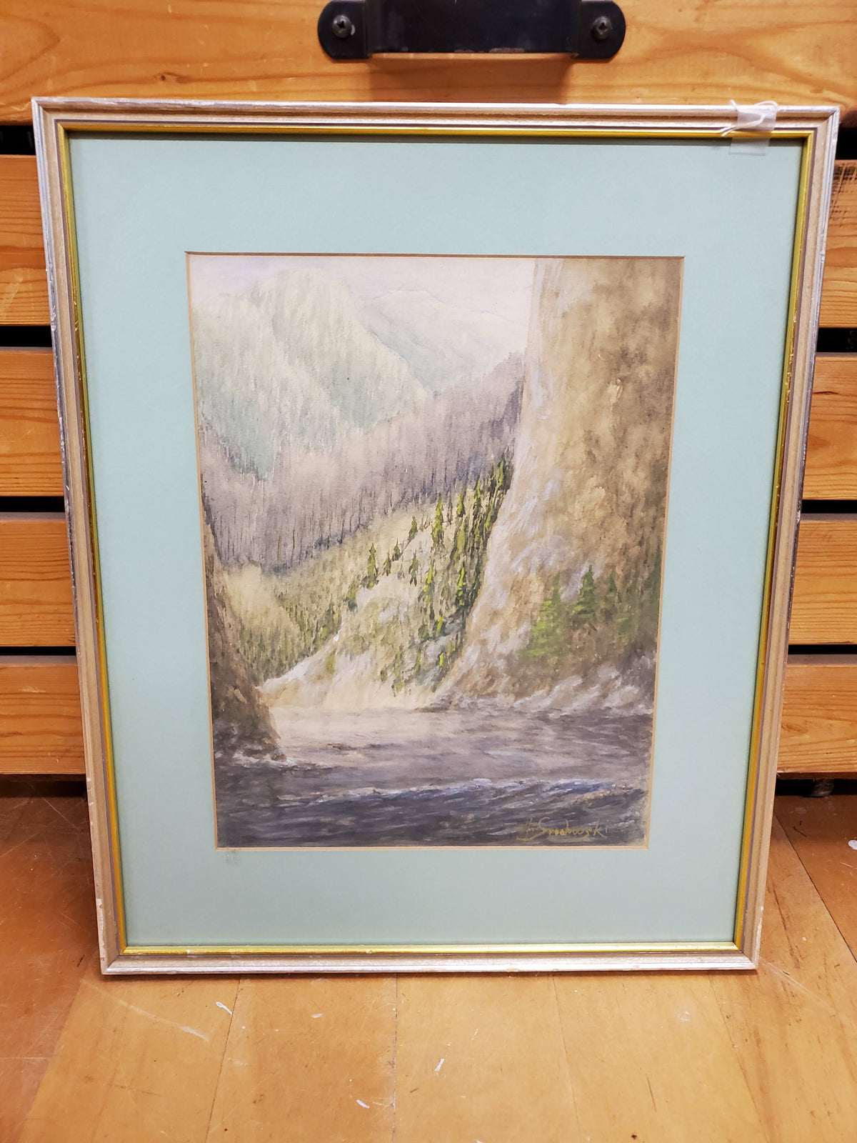 Framed watercolor print of mountain side