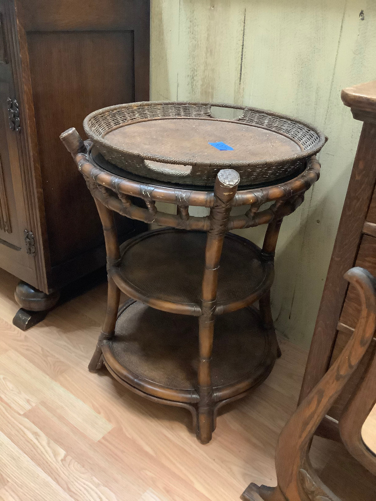 Round wicker table with glass top and tray